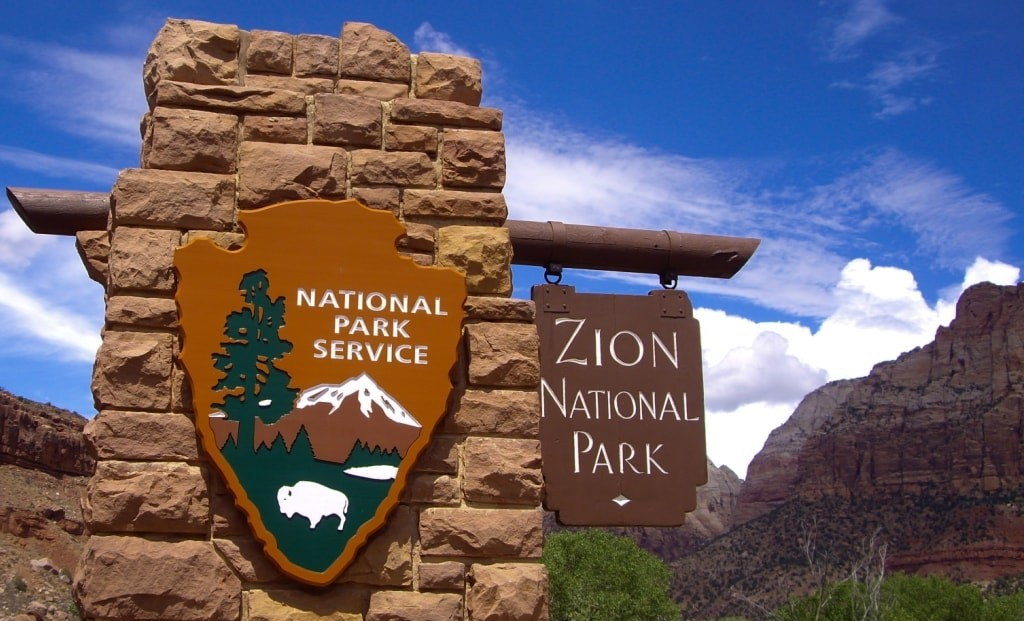 Blog - Zion National Park Sign - Emattil (Shutterstock 211242988) 1024x621-min